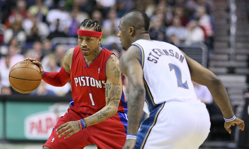 Iverson dribbles past a player for the Pistons