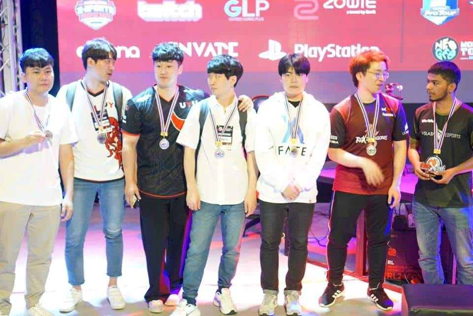 Several esports and tekken athletes celebrate with their medals