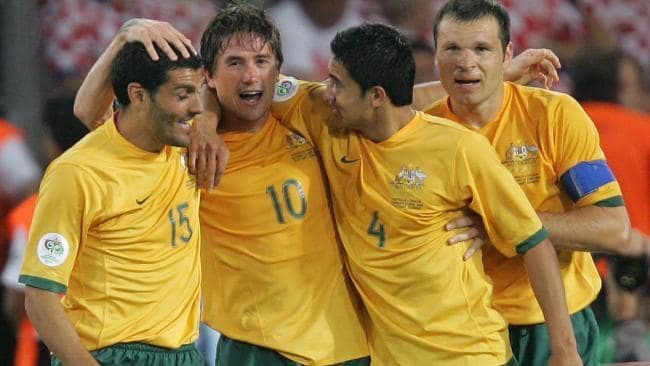 Harry Kewell Tim Cahill and Mark Viduka celebrate a Socceroos Goal in football
