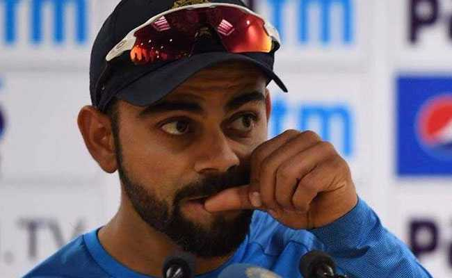 Virat Kohli bites his nail during a press conference