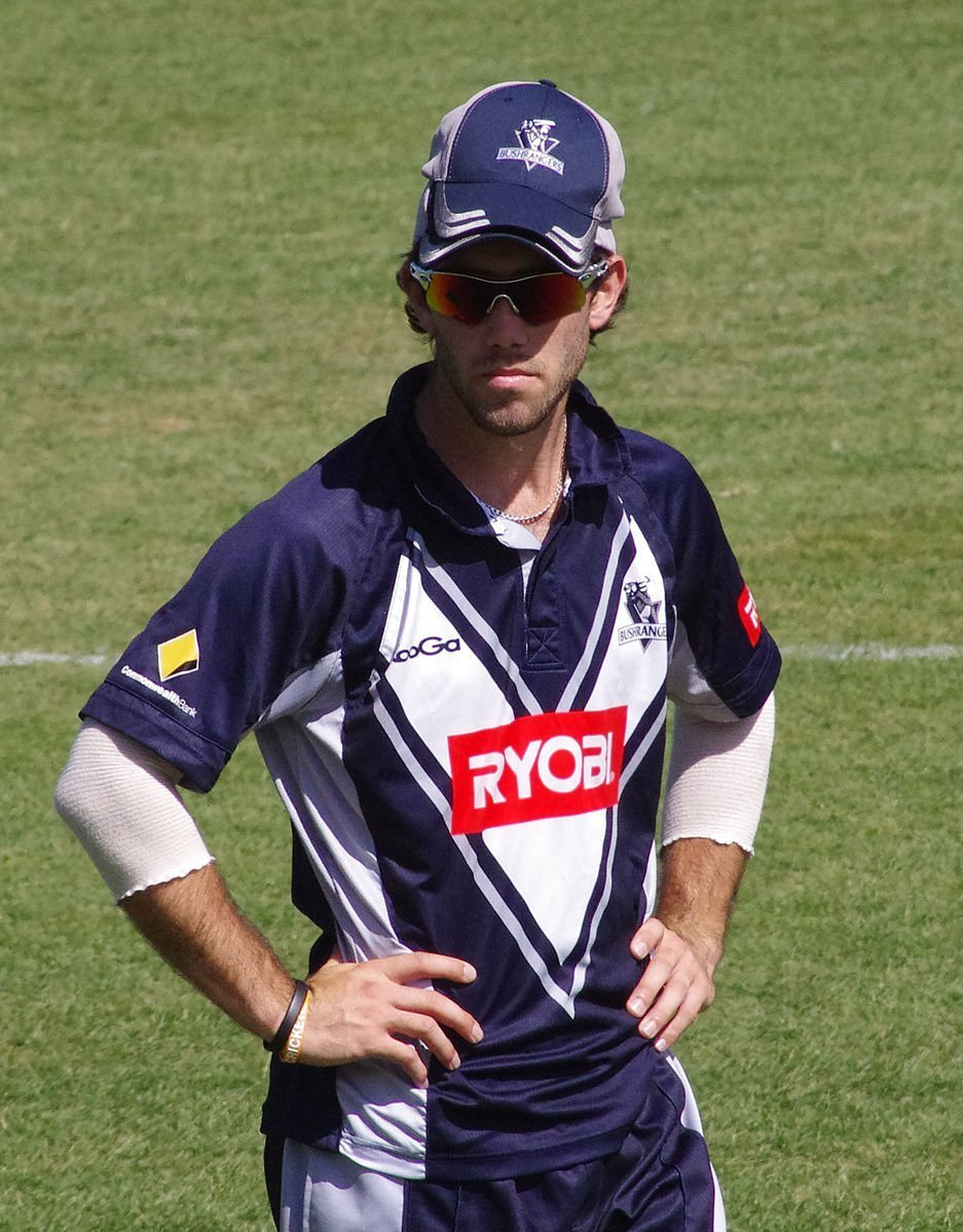 Glenn Maxwell stands on the field for his local team