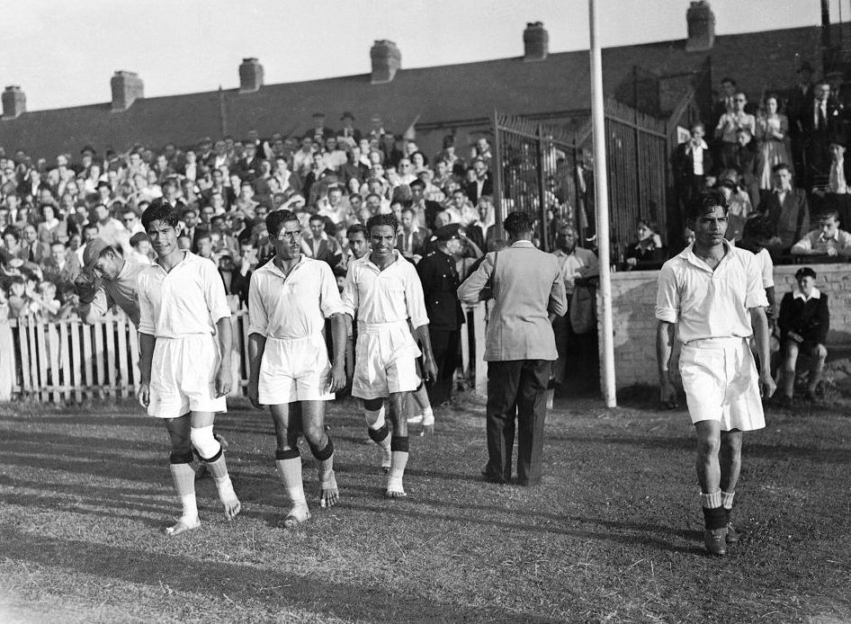 Indian football players walkout at Ilford for their match against France, the majority of them bootless