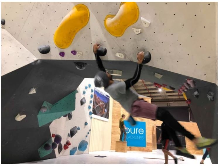 The author climbing a sports (bouldering) climbing route