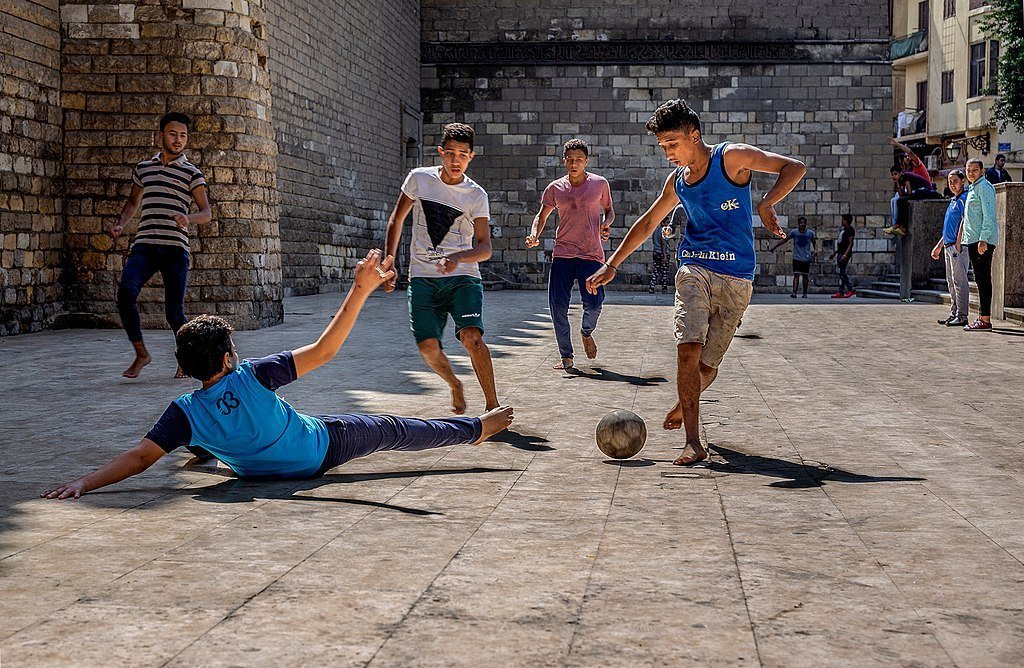 Boys-playing-street-football-in-egypt