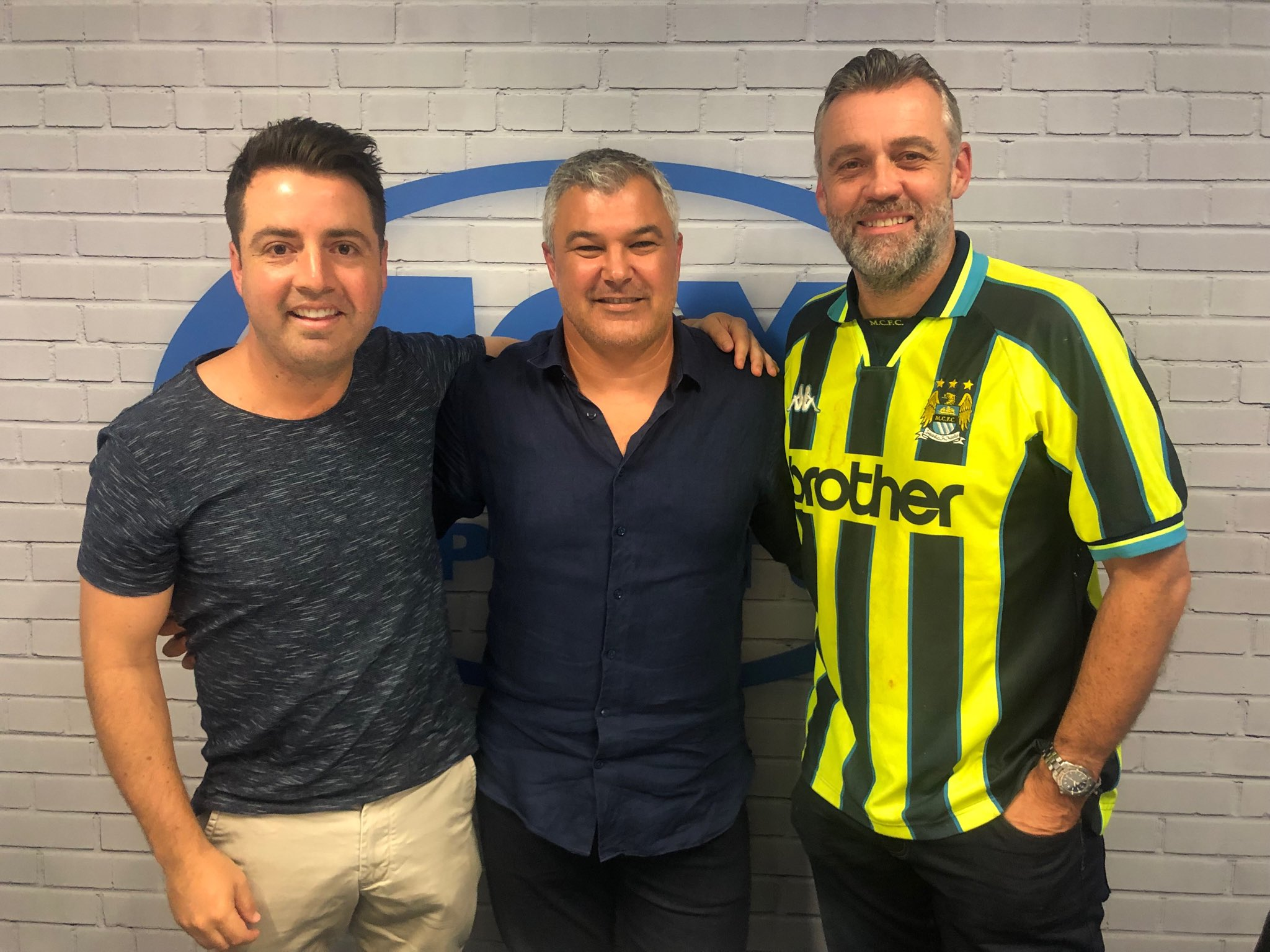 Simon Hill with co-host of his podcast and Phil Moss