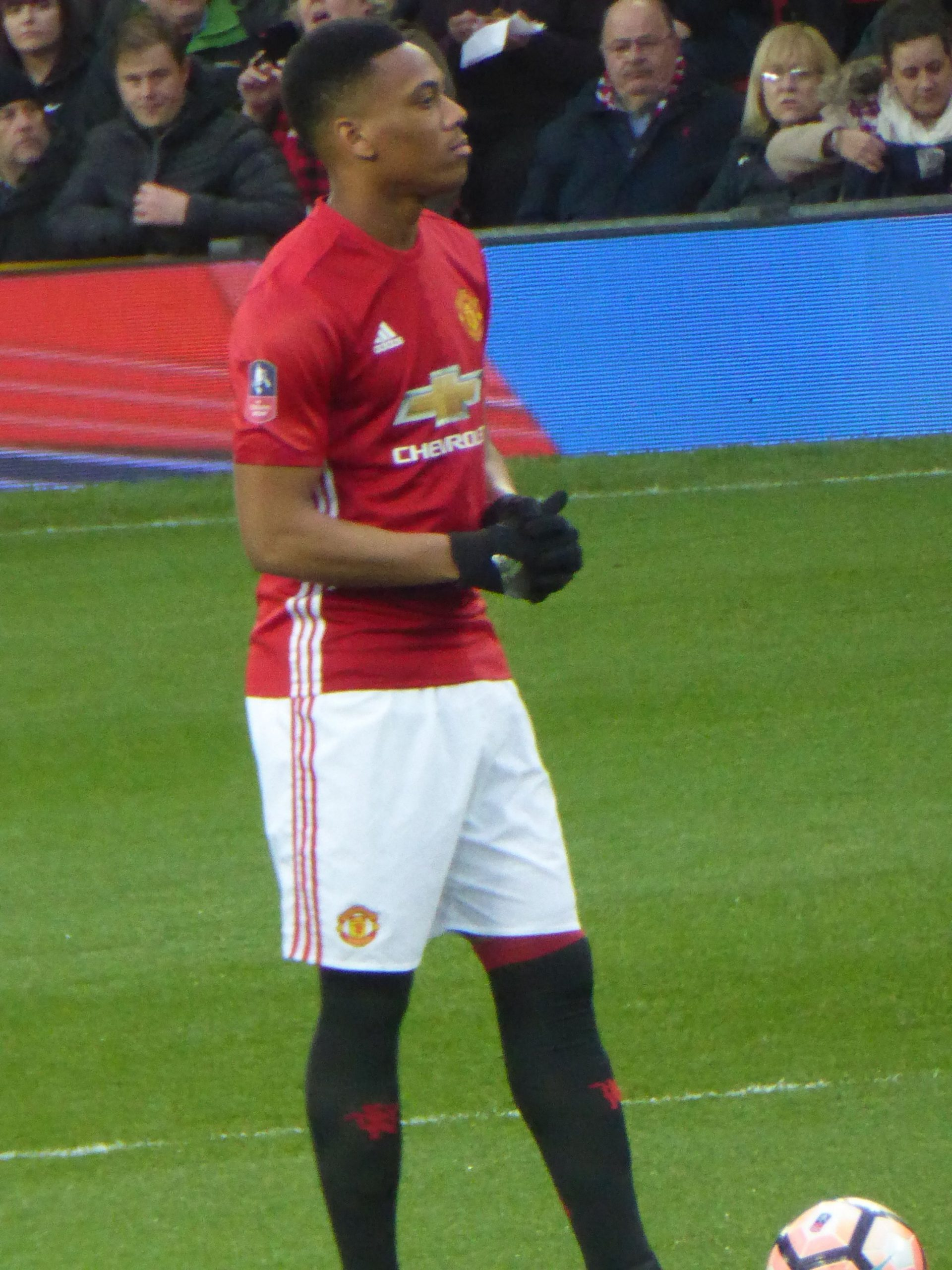 Anthony Martial in his Manchester United Kit on the field against Liverpool