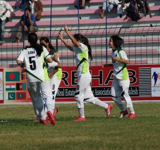 Pakistan women's football team celebrates a goal