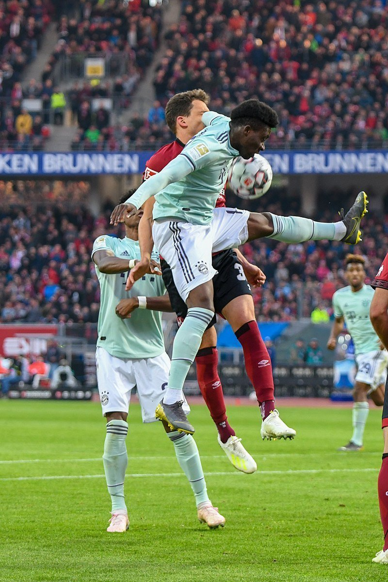 Alphonso Davies, Bayern's star, tries to head the ball
