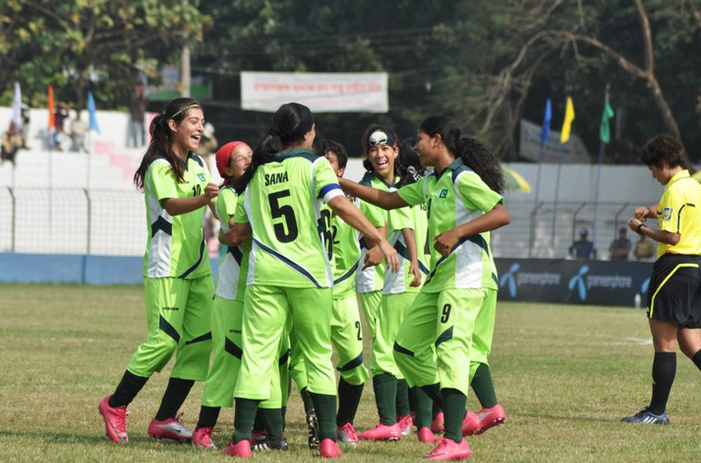 The Pakistan women's football team and celebrating a goal