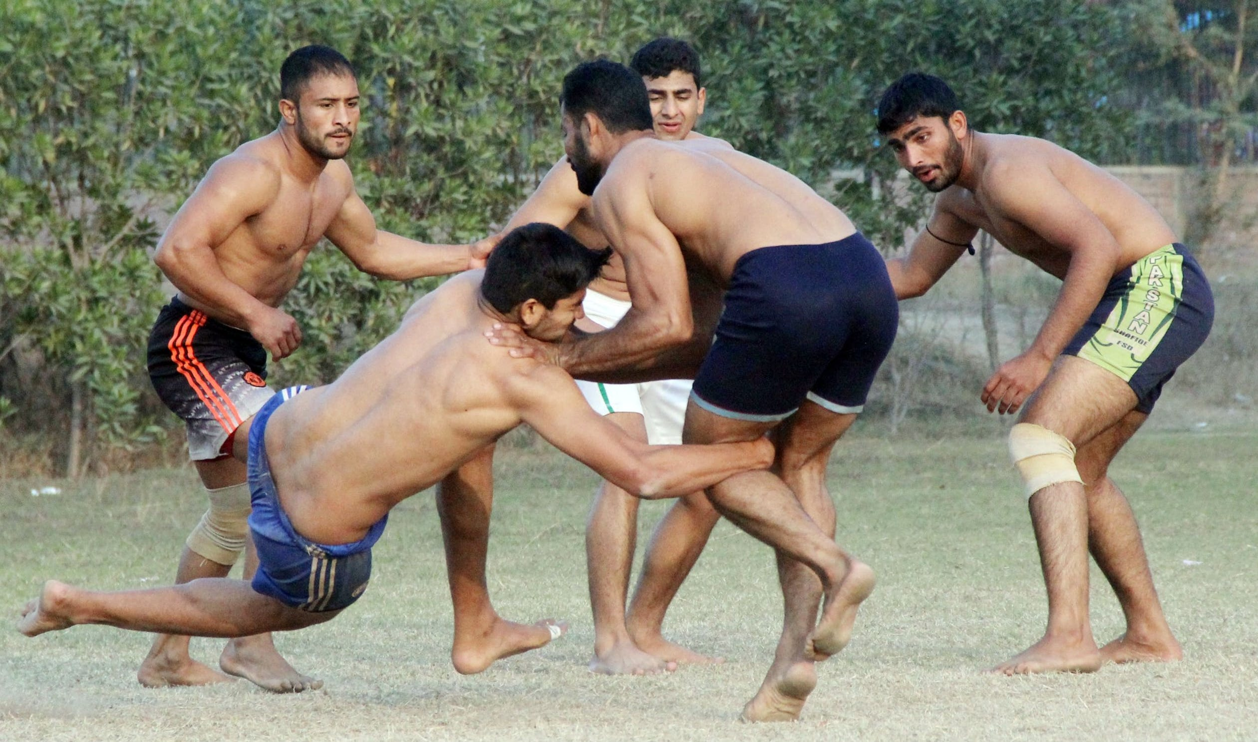 Men play kabbadi in Lahore