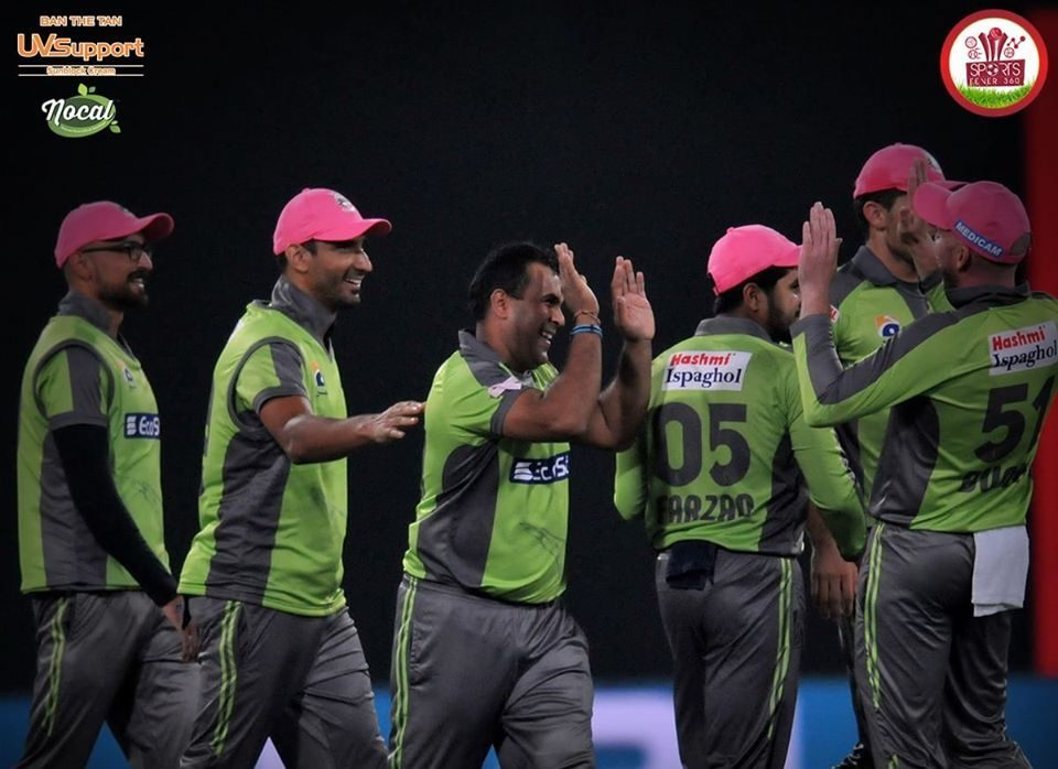 Lahore Qalandars celebrate a wicket with high-fives in the PSL