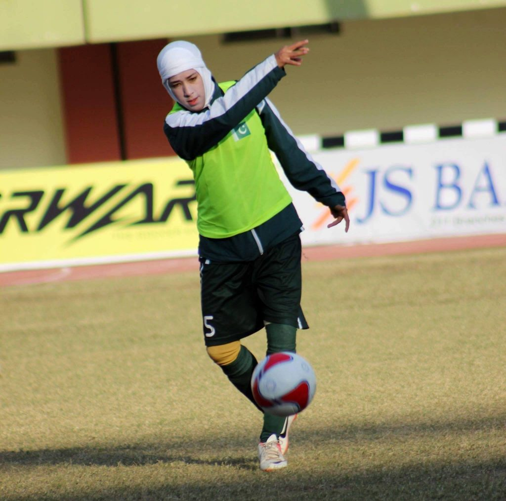 abiha haider throwing football during match AFL