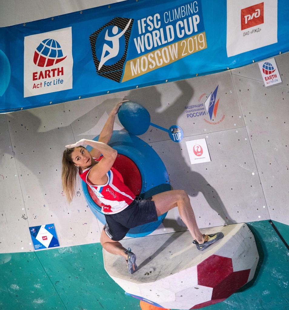female climber climbing in indoor gym