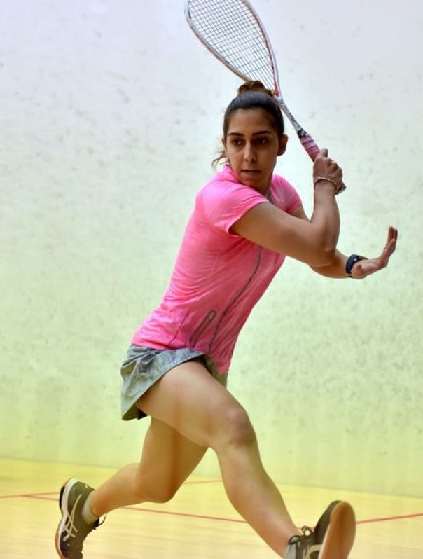 Nadine Shahin hitting a backhand shot during a match