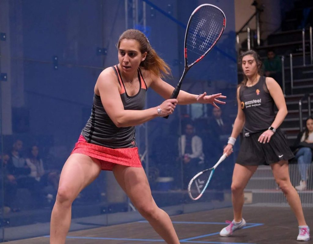 Nadine Shahin hitting the squash ball (Egypt player)