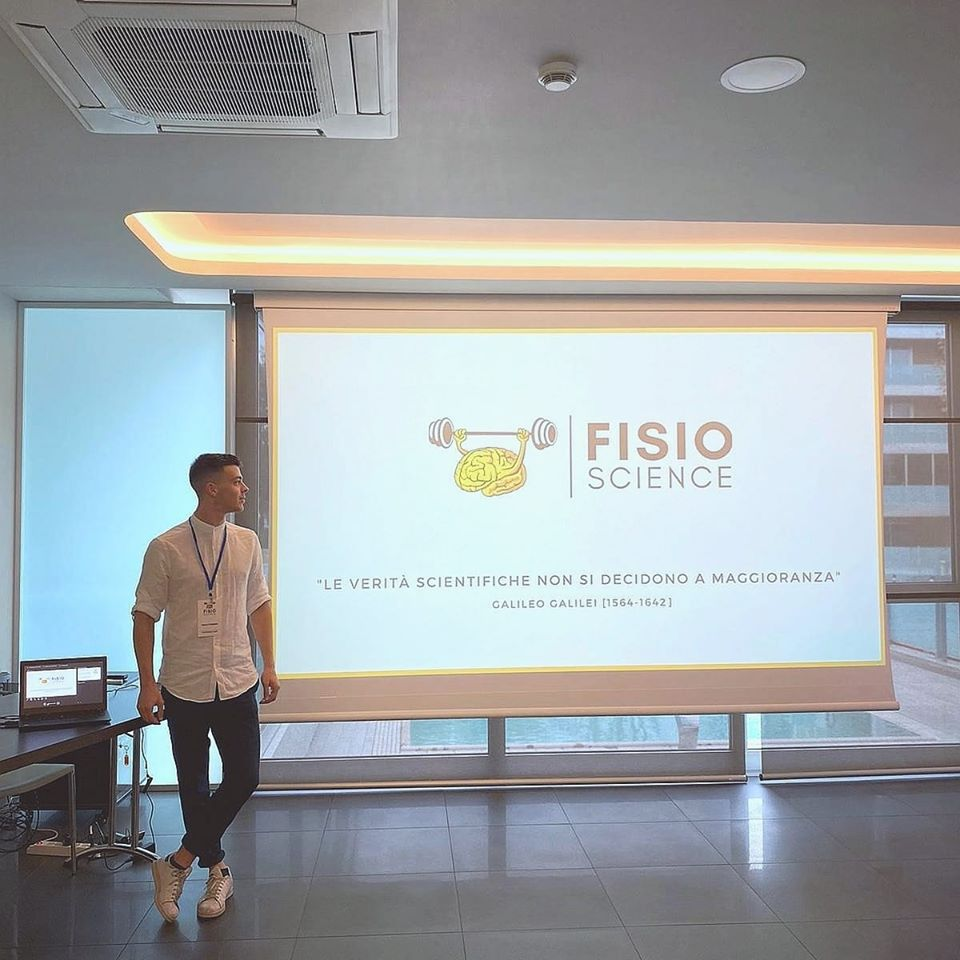 Paolo Torneri poses with a presentation of his business fisioscience