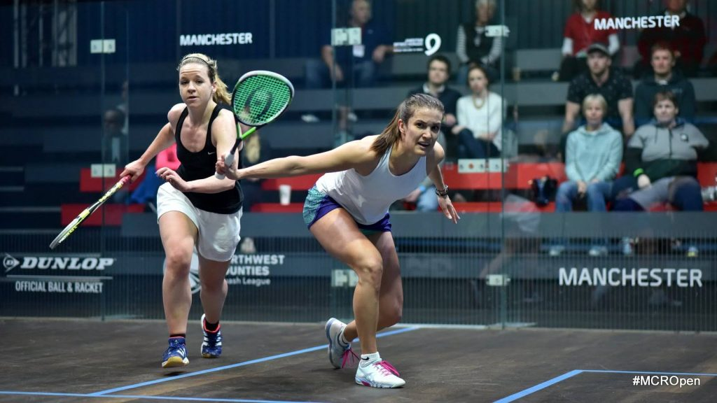 Samantha Cornett playing against each other during a squash match Canada)