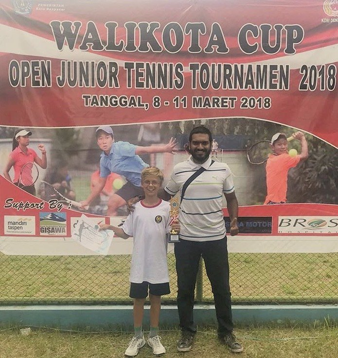 zamir mohamed yacob with a young boy during junior tennis tournament