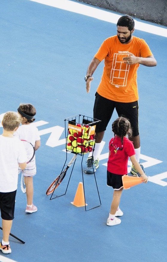 zamir mohamed yacob having with kids during tennis practice