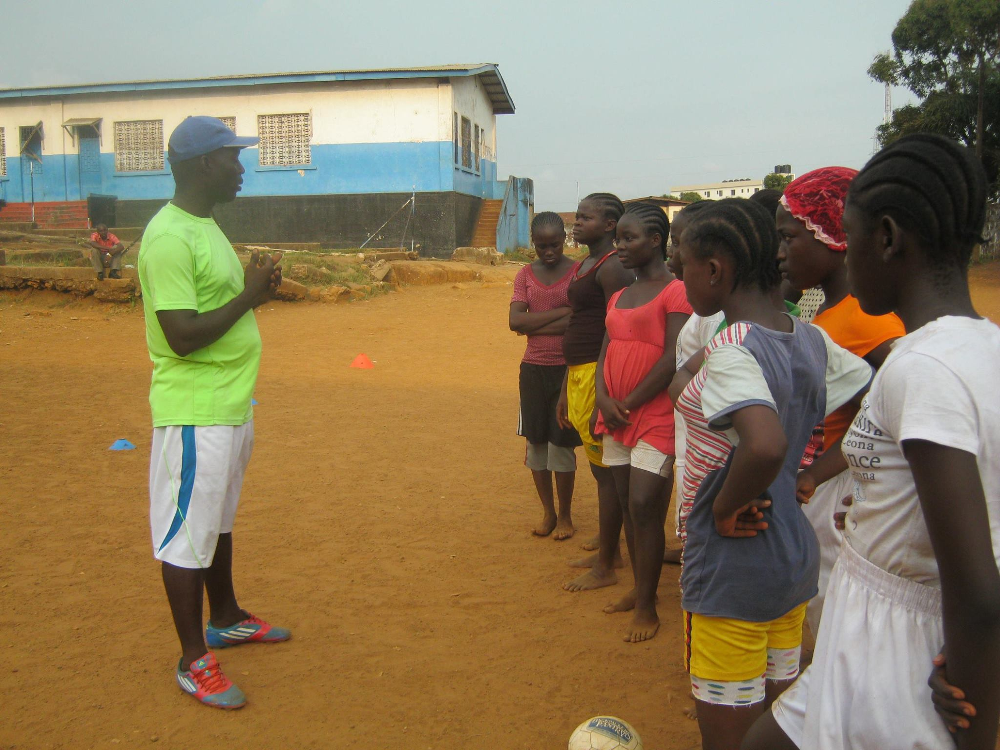 Pappie Jones coaching the youth with Soccer Ambassadors Liberia