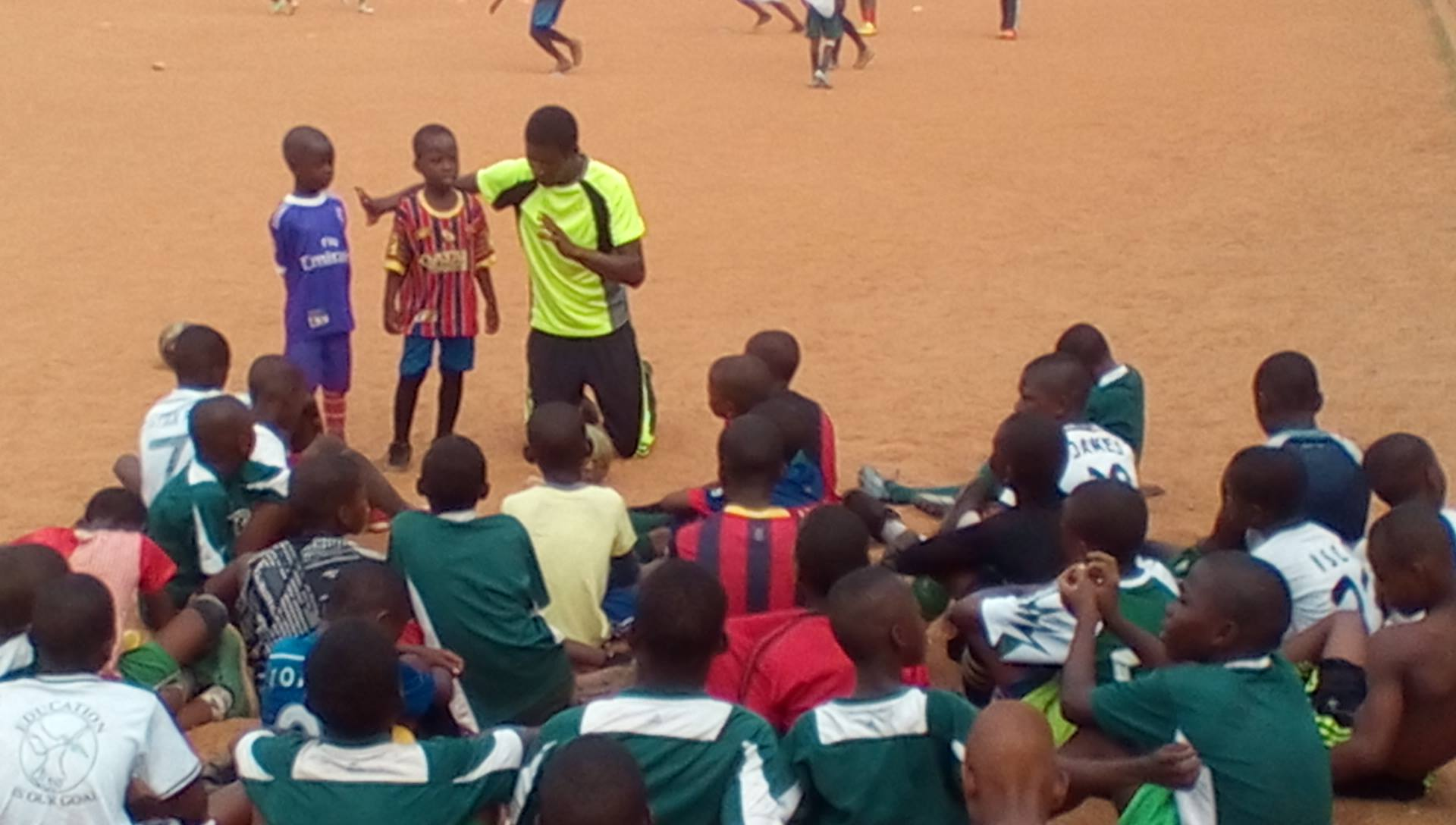 Children are instructed about football