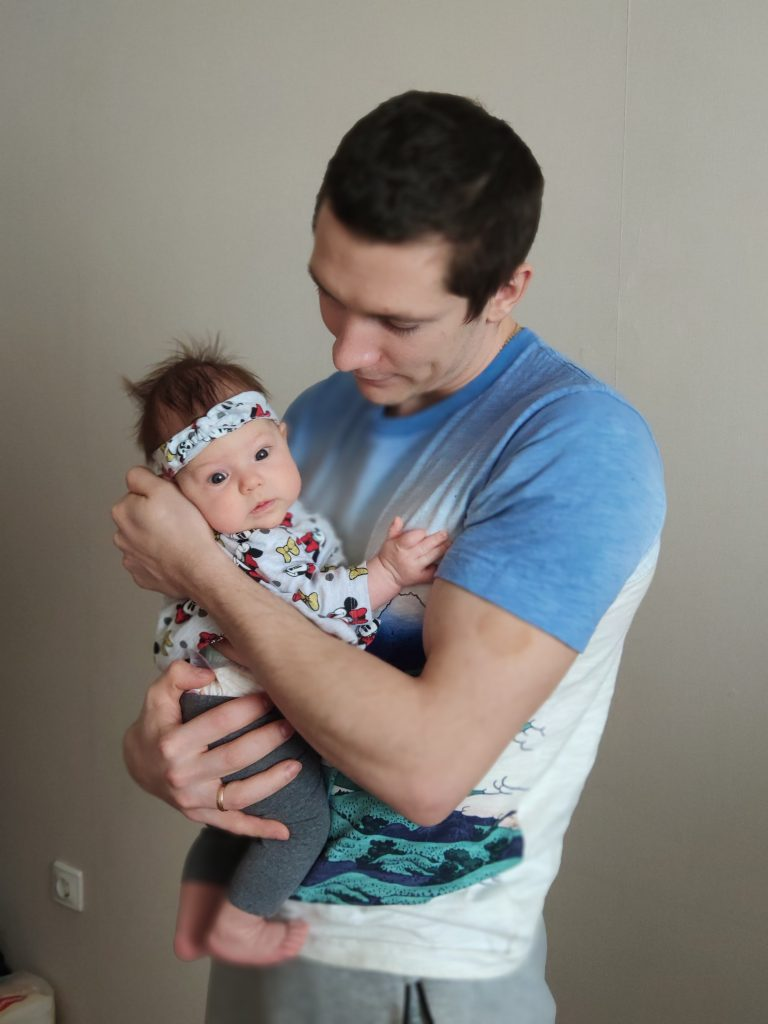 dmitrii timofeev holding his daughter