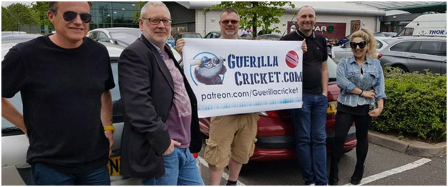 five-members-of-team-guerilla-holding-a-poster