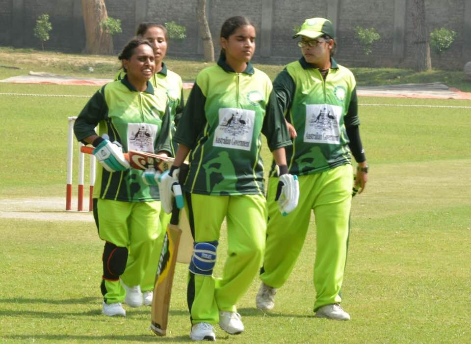 The Pakistan women's blind cricket players walk off the ground after a batting excursion